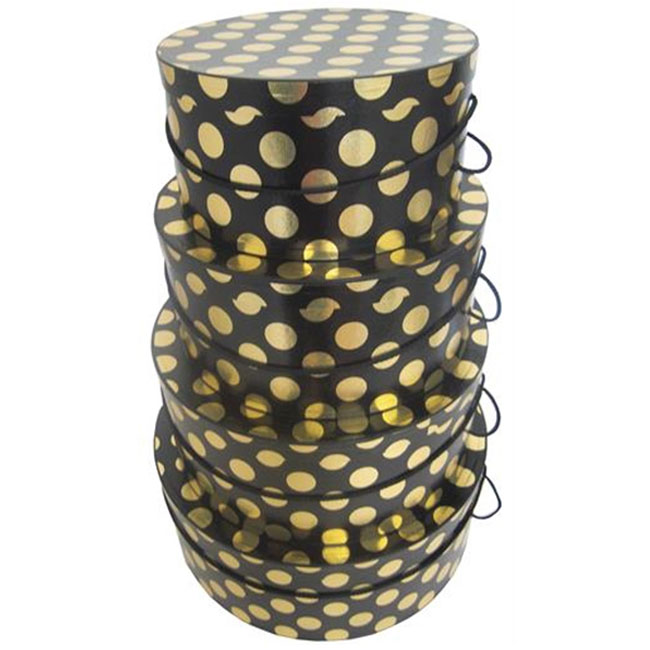 nested round hat boxes, black and white polka dots